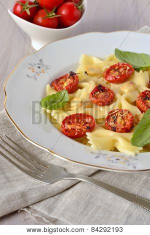 Farfalle with baked tomatoes and basil