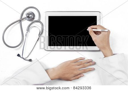 Practitioner Hands With Tablet And Stethoscope