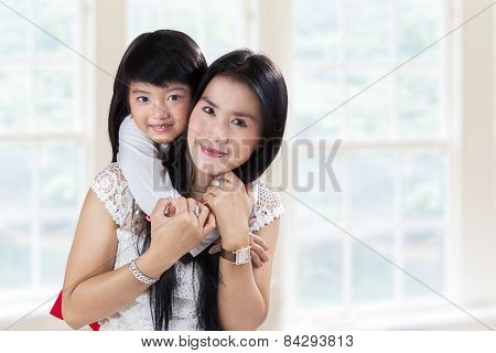 Pretty Mother And Her Daughter At Home