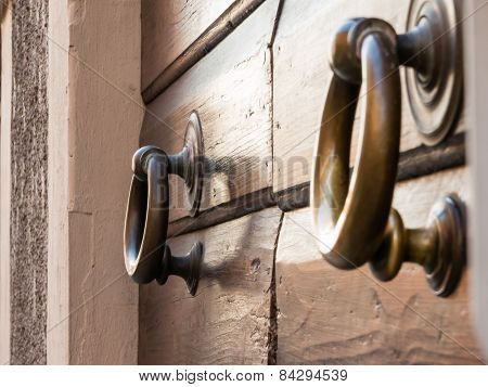 Brassy Doorknob On Wooden Door, Two Handles