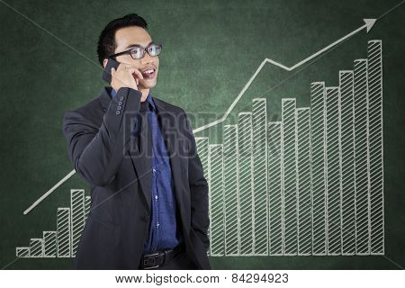 Successful Worker With Growing Financial Chart