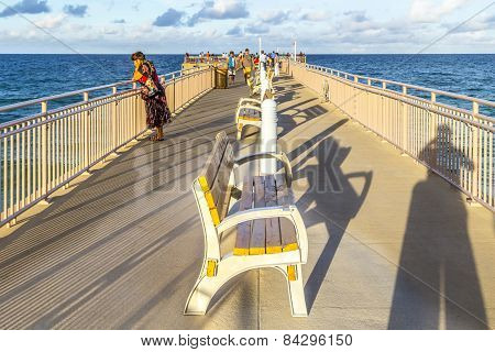 People Enjoy The Fishing Pier In Sunny Isles Beach