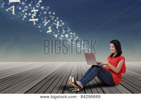 Woman Sending Information To Cloud Storage