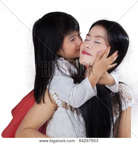 Young Girl Kiss Her Mom In Studio