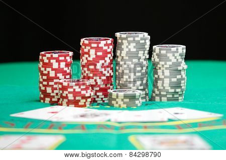 Colorful Poker Chips On Green Background With Copy Space