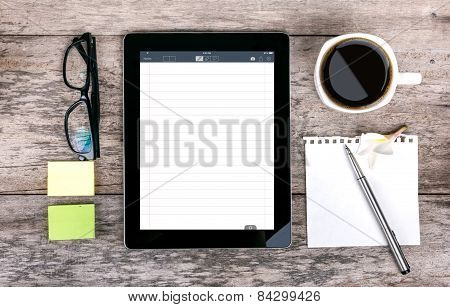 Digital Tabletdigital Tablet As A Note Pad  And Coffee Cup Wit  On Wooden Table And Coffee Cup On Wo