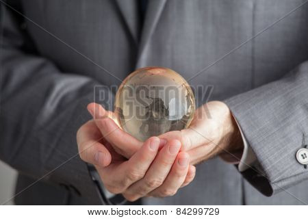 Hand Of The Person Holds Globe, Earth In Our Hands,  Green Geothermal Energy
