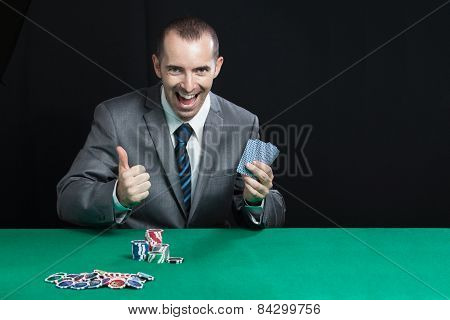 Blackjack In A Casino Happy Man Wins Gets Rich, Screams smile and shows a big like