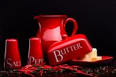 foto of pepper  - Closup of red gloss ceramic salt - JPG