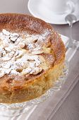 stock photo of cake stand  - apple cake with almond sliver and powdered sugar on a cake stand - JPG