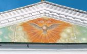 stock photo of holy-spirit  - beautiful painted dove holy spirit on the facade of the temple - JPG