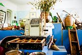 image of cash register  - Vintage cash register with money drawer open surrounded with bunch of antiques - JPG