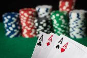 pic of poker hand  - four of a kind poker hand Aces with poker chips - JPG