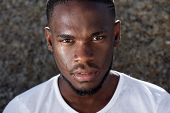 foto of dripping  - Close up portrait of a young african american man with sweat dripping down face - JPG