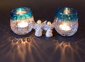stock photo of christmas angel  - Two little angels and burning tea lights for christmas - JPG
