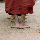 picture of emaciated  - Foots of ascetic Buddhist monk walking at the way to Kyaikhtiyo - JPG