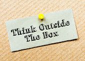 stock photo of thinking outside box  - Recycled paper note pinned on cork board - JPG