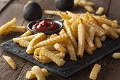 picture of grease  - Unhealthy Baked Crinkle French Fries with Ketchup - JPG