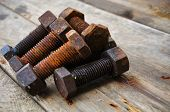 foto of bolt  - Old bolts or dirty bolts on wooden background - JPG