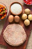 image of flat-bread  - Traditional Bolivian meat called Silpancho which is a breaded flat round piece of beef meat served with fried egg rice fried potatoes and vegetables  - JPG