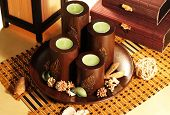 image of casket  - Composition of four decorative candlesticks in the Japanese style on a background of bamboo caskets - JPG