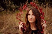 stock photo of auburn  - cute young woman with long auburn hair in the autumn field - JPG