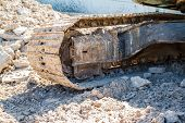 pic of wheel loader  - Shovels with steel wheels in plant construction - JPG