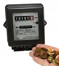 stock photo of electricity meter  - electric meter and the hand full of European currencies - JPG