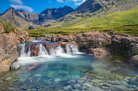 stock photo of chute  - A small waterfall at the fairy pools on the Isle of Skye - JPG