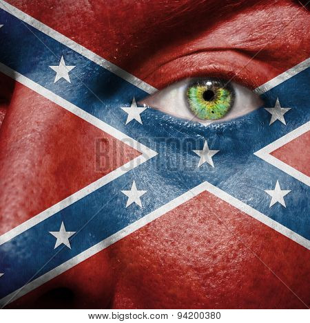 Confederate Flag Painted On A Man's Face