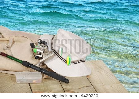 closeup of spinning fishing equipment on a dock