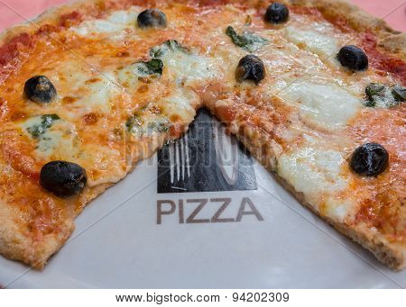Pizza With Olives And Basil