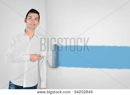 Closeup young man painting on wall