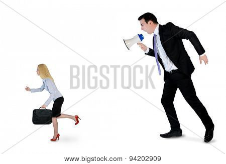 Business man screaming on megaphone on little woman