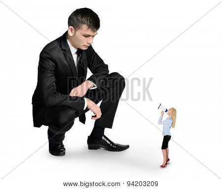 Isolated business man looking at little woman