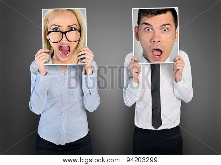 Shocked face of business woman and man