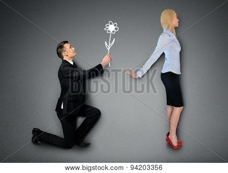 Business man giving flower to girlfriend