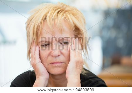 Very worried middle-aged woman