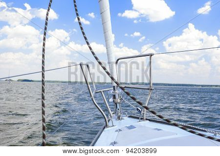 Bow Of The Small Yacht Under Sailing On Open Waters.