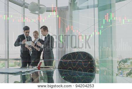 Three Business Person Discussing With Graph Layer Effect