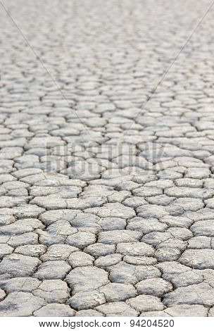 Closeup Of Dry And Cracked Mud Soil In Racetrack Playa In Death Valley National Park In California