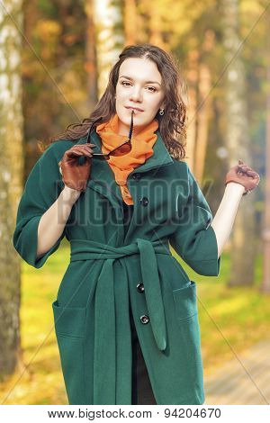 Stylish And Fashionable Caucasian Brunette Female Model Outdoors