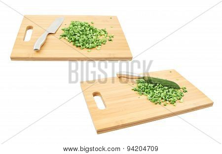 Cut in pieces green onion over cutting board