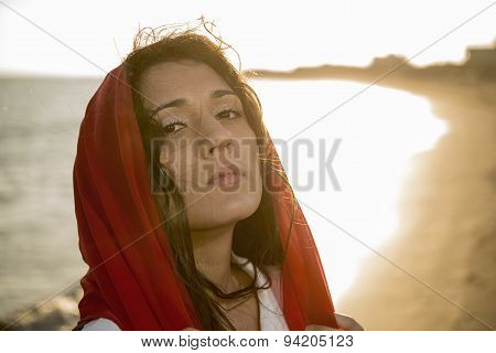 Direct Look Of A Girl On The Beach With A Red Scarf