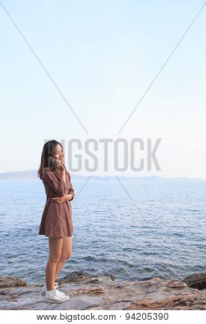 Portrait Of Young Beautiful Asian Woman Talking Smart Phone At Sea Side Use For People And Modern Te