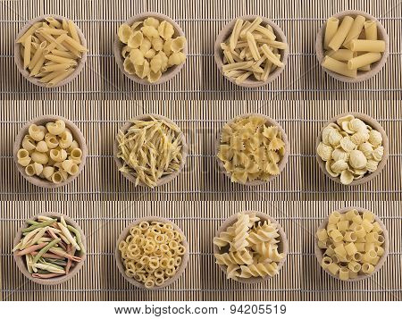 Various Types Of Raw Pasta In A Wooden Bowl