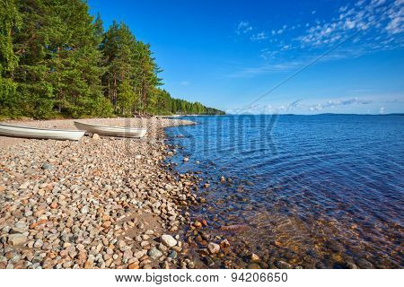 Lake shore with boats. Finland morning landscape.