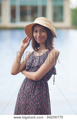 Portrait Of Smiling Face Of Young Asian Tan Skin Woman With Long Dress And Fashion Wide Straw Hat St