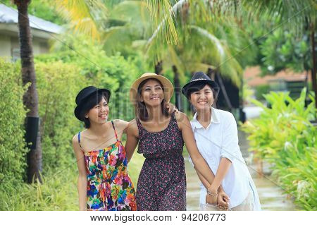 Portrait Group Of Asian Young Woman Friends Walking In Park With Relaxing Emotion And Happiness Face