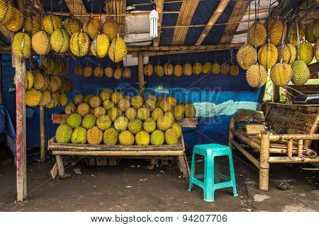 Durian fruits street market stall, Sumatra, Indonesia. Durian regarded by many people in southeast Asia as the